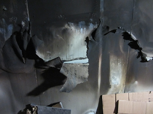 Outer wall of ModuSec computer room facing fire