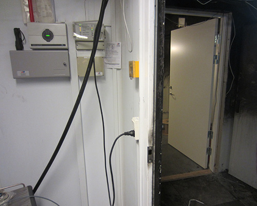 View out of ModuSec room to damaged outer room (with new emergency security door to outer area)